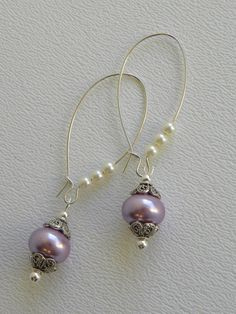 Lavender Rondell Pearl Handmade Beaded Earrings Silver Beads. $12.00, via Etsy.