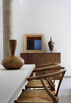 Rattan dining chairs and an African vase for decor