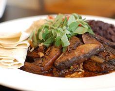Portobello Mushroom Soft Tacos (DF-V-Spicy):Seared portobello mushrooms w/ salsa ranchero, ancho chile black beans, brown rice & flour tortillas