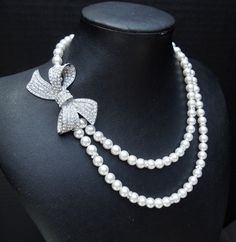 bows, rhinestones and pearls?! What's not to love...about this costume bridal necklace.