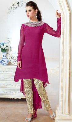 Reign in classic charm and grandeur by draping your self into this magenta color georgette asymmetrical pant style suit. The lace, resham and stones work appears to be like chic and great for any celebration. #pantstylesuit #designerpantsuit #designer