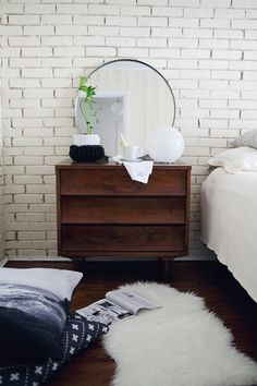 John has room for a small dresser like this to serve as a bedside table. More storage space!