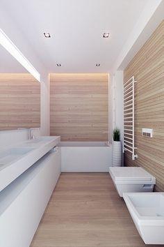 Un design épuré habite cette salle de bain en bois clair et blanc