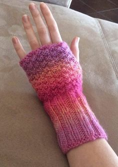 Free knitting pattern for Comfy Knit Wristers - Easy fingerless mitts. Nazanin S. Fard's hand warmers for Red Heart feature moss stitch and ribbing and are knit in the round with dpns or magic loop. Designed for multi-color yarn!