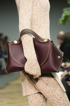 Cross between the clutch and handbag.
