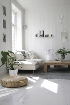Calming white lounge with lots of plants