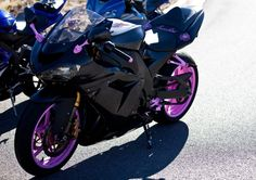 Here is a pick of my 2005 Kawasaki ninja zx10r... Its a chameleon gunmetal grey with hot pink accents..:
