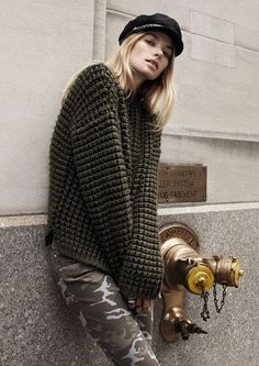 Army green sweater and camo. Jessica Hart.
