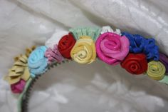 Pretty handmade leather flowers in multi colours arranged on one side of a hairband, made to look good so it doesnt matter which side of your face its worn. Pink, blue, mint, yellow, white, red and purple. These bands are custom made so if this doesnt suit I can make your own colour preference providing Ive the colours in stock. Suitable for 3 yrs up. Designed and handmade by Ruby62 Please take the time to look at my other items, most can be made in different colours, theres no extra…
