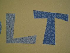 i am sooo excited!!! watch out walls, here i coome :)    a tutorial on ironing fabric to the wall!