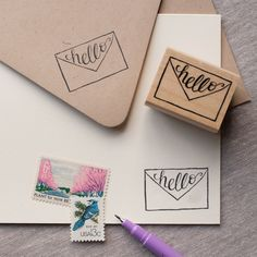 Make your own notecards, or just add a little special hello anywhere that needs it! Stamp this hand lettered 'hello' on cards, tags and anything else your heart desires. Looks amazing with a littte em