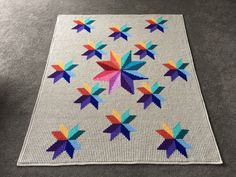 Star compass colourful crochet blanket. http://www.ravelry.com/projects/cuddlycritter/carpenter-wheel-variation-blanket