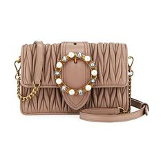 """Lady Mini Matelassé Crossbody Bag by Miu Miu. Miu Miu crossbody bag in matelass leather with golden hardware. Removable chain and leather shoulder strap. Flap top with pearlescent and crystal buckle. Dual magnetic snap closure. Interior, two slip pockets. 4.3""""H x 7.1""""W x 2""""D. Made i... #miumiu #bags"""