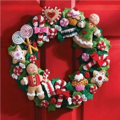 BUCILLA-Felt Wreath Kit: Cookies and Candy. Decorate your home for the holidays with this beautiful seasonal wreath. This kit contains everything you need to make one 15-inch wreath with candy decorat