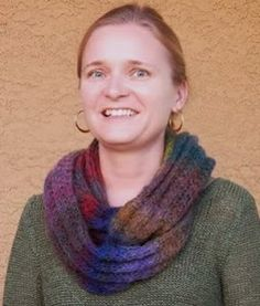 This gorgeous knit infinity scarf pattern is too quick and easy not to make. The Wildflower Infinity Scarf is knit in a beautiful colorway full of deep blues and purples, rich red, muted golds, and pretty greens.