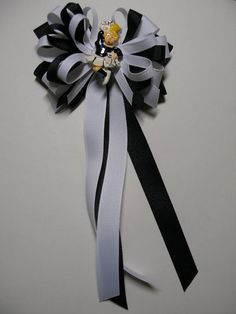 Hello and Welcome,    Do you have a future little cheerleader? She is sure to like a big girl cheer bow. This bow measures approx. 4 inches in size which is perfect for a little one/toddler size. The bow has black and white grosgrain ribbon including streamer/tails that hang down approx. 7 inches in length.    Please Note: for those bows with novelty pieces and embellishments--- I take great care to adequately secure novelty pieces onto my bows. As a safety precaution, I recommended that…