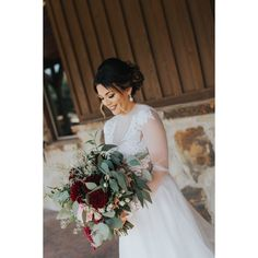 Such a gorgeous, deep red bouquet for a winter wedding!  Love the overflowing greenery + unique textured blooms.  The perfect, winter bouquet! Photo taken at THE SPRINGS Event Venue.  Follow this pin to our Instagram for more photos! #bouquet #winterbouquet #winterwedding #weddingflowers #bouquetideas #winterweddingflowers #weddinginspiration #weddingdetails #weddinginspo