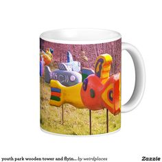 youth park wooden tower and flying wooden fishes coffee mug