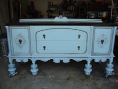 Pretty turquoise buffet with dark stained top with dark glaze accenting the detail.