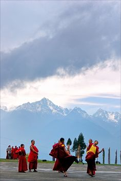 Monks playing at the premise of New Ralang Monastery,Ravangla,South Sikkim, India with the view of Mt. Kanchanjunga in the background.