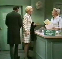 Matt and Maggie sign out for the day at the third floor nurses' desk. Nurse Edie is the behind the desk.