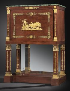 A MAHOGANY AND SECRETARY GILTBRONZE SEAT, EMPIRE, Attributed to JACOB-DESMALTER, THE BRONZE Attributed To PIERRE-PHILIPPE THOMIRE the top opening with a flap wheel on the back of a golden green leather small iron and discovering five drawers, two shelves and two secret compartments; based on straight feet; beautiful ornamentation of gilt bronze; low Apollo representing relief on his chariot medallions depicting the Fables of La Fontaine: The Eagle and the Owl, The Fox and the Crow