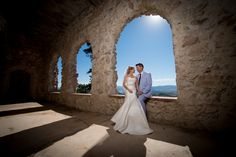 Cherokee Castle and Ranch Wedding Bride and Groom Looking at Each Other in Front of Stone Archway