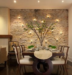 We have the perfect wall for this...yes! (I like the centerpiece as well!) dining room accent wall stone