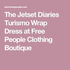 The Jetset Diaries Turismo Wrap Dress at Free People Clothing Boutique