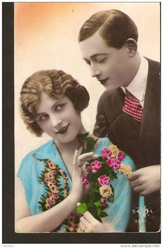Couple - Man & Woman with flowers - tinted real photo postcard made in France SOL 3261