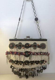 Charms, colourful beads and numerous amulets give this awesome purse a unique bohemian look. Bohemian Look, Boho, Charmed, Ceiling Lights, Amulets, Purses, Beads, Unique, Handbags