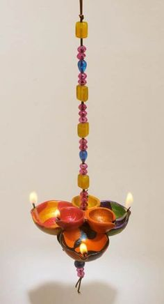 Diwali Decoration Ideas For 2018 The essence of Diwali lies in its decoration. So express your creativity this Diwali by taking cues from our Diwali decoration ideas. Diya Decoration Ideas, Diy Diwali Decorations, Decoration For Ganpati, Festival Decorations, Hanging Decorations, Hanging Ornaments, Decor Ideas, Craft Ideas, Diwali Craft