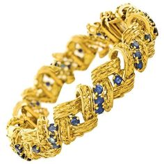 Preowned Tiffany & Co. Retro Sapphire Gold Bracelet ($9,800) ❤ liked on Polyvore featuring jewelry, bracelets, blue, gold bangles, retro jewelry, 18k gold jewelry, 18k bangle and sapphire jewelry