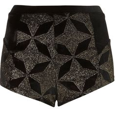 Topshop Black Velvet Star Shorts US 2 Black velvet shorts with sparkly gold star pattern. High cut. Perfect for holidays. Can be layered over some black tights. New without tags. Never worn. EUR 34/ US 2/ UK 6 Topshop Shorts
