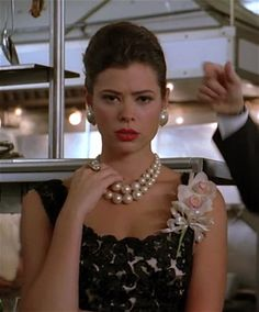 Season 3, Episode 12, Roger's new wife wears this set of massive faux pearls around her neck, paired with huge faux pearl button earrings, ringed with clear round chaton rhinestones.  Love it!