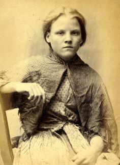 Along with Mary Catherine Docherty, Ellen Woodman and Mary Hinnigan, Rosanna Watson was sentenced to 7 days hard labour after being caught stealing iron.  Age (on discharge): 13 Height:                        4.11 Hair:                            Light Brown Eyes:                           Dark Blue Place of Birth:            Durham Status:     Single  These photographs are of convicted criminals in Newcastle between 1871 - 1873.  Ref...