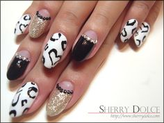 Black, Gold, and White Shinny Heart Rhinestone Japanese Nail Art Manicure.