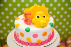 How cute is this girly dinosaur cake