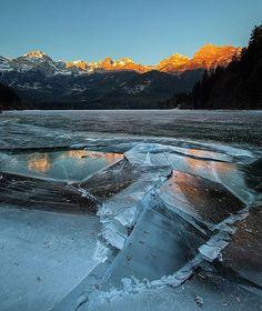 Tovel winter sunrise  #parcoadamellobrenta  Photo by: @alessandro_toller  __________ #Tovel #sunrise #ice #frozen #lake #lagoditovel #valdinon #dolomiti #dolomitidibrenta #dolomites #dolomiten #valdisole #valrendena #sunset #trentino  #instatrentino #trentinoaltoadige  #trentinodascoprire #madonnadicampiglio #pinzolo #molveno #andalo #italianlandscape #landscape #italian_places #bestmountainartists #italy