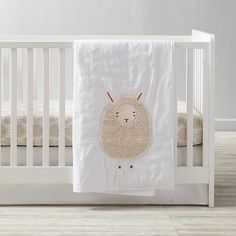 We're not shy when it comes to talking about our Sheepish Crib Bedding. The baby quilt is made from a super soft cotton and linen blend and has an adorable appliquéd sheep. The 100% cotton crib fitted sheet features a flock of printed sheep. Add the coordinating linen crib skirt to round out the look. Designed exclusively for us by Gingiber.<br><br><NEWTAG/><h2>Details, details</h2><ul><li> Nod exclusive</li><li> A Gingiber design</li><li> Baby Quilt is made of a cotton and linen…