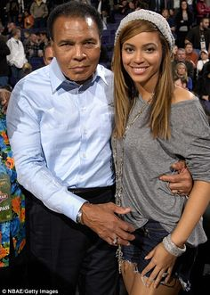 Legend: Muhammad Ali poses happily with Beyonce Knowles at the NBA All-Star basketball game in Phoenix, Arizona, yesterday