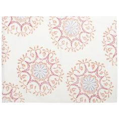 Jama Place Mat  - The designs in this season's tabletop range from small poppy prints to large Suzani motifs comprised of floating medallions. By block printing these designs, they inherently take on the perfect level of casual.
