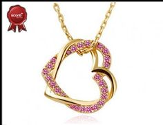 """#Damas - Tierno dije """"Love me two times"""" con incrustaciones de cristales de Swarovski Elements en color rosa, muy elegante. Tiene baño de oro amarillo de 18K. Es joyería hipoalergénica. ¡Aprovecha esta oferta con 49% de descuento! / Ver detalles completos: https://sconti.com.mx/index.php/frontend/campaigns/single/4339/Tierno-dije-Love-me-two-times-con-diseo-de-corazones-entrelazados.-Un-accesorio-muy-elegante"""