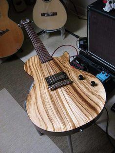 Custom electric guitar with exotic woods grain