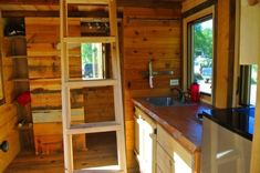 stanley-rocky-mountain-tiny-houses-log-cabin-on-wheels-flipping-overhangs-greg-parham-00012