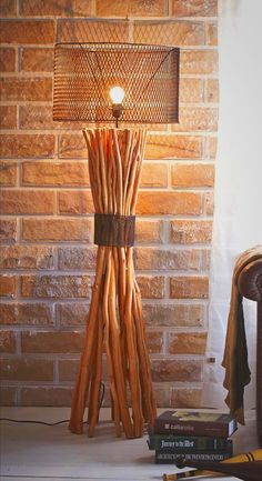 Great Unique Industrial Style Floor Lamp! Made from high quality wood branches, bunched together with metal mesh. With a rusty look metal shade, this Masterpiece looks gorgeous and creates ambiance environment. It's great when place on one side of your couch and a wooden side table or stump on another. This is perfect for loft and industrial style decoration. Find more Creative Ideas from O'THENTIQUE's Designer on our site!