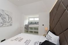 This loft In the centre of Prague, Czech Republic, from OOOOX is a cool Interpretation of the classic Black-and-White theme. The apartment is small, but it Black And White Interior, White Interior Design, Apartment Interior Design, White Apartment, Minimalist Apartment, Minimalist Interior, Tara Verde, Reading Loft, Tiny Loft
