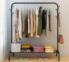 The Ciara floor standing clothes rack is the perfect piece for keeping your clothes and other posessions organized. Made from sturdy iron. Free Worldwide Shipping & Money-Back Guarantee