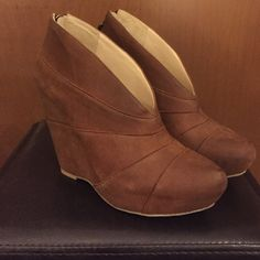 """Brown Wedge Booties - Size 7M NWOT Adorable brown leather wedge booties by Boutique 9. Approx 4"""" heel; 8.5"""" long; 3"""" wide. Never been worn. Excellent condition. Boutique 9 Shoes Ankle Boots & Booties"""