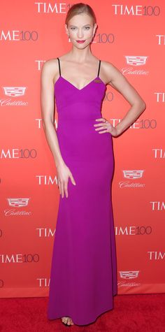 Karlie Kloss showed off her svelte supermodel bod at the 2016 Time 100 Gala in a violet Victoria Beckham design that hugged her every curve. She pared down on accessories and finished her look with tiny diamond bar studs and Manolo Blahnik heels.